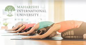 Row of people doing asanas together * Maharishi International University